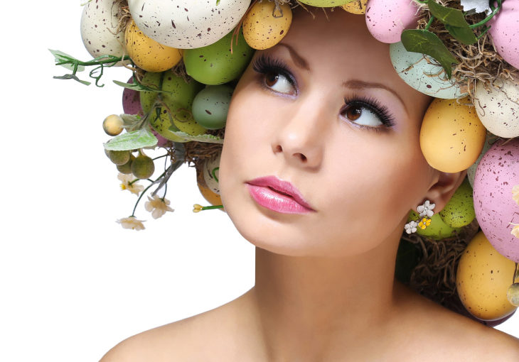 Easter Woman. Spring Girl with Colorful Eggs.